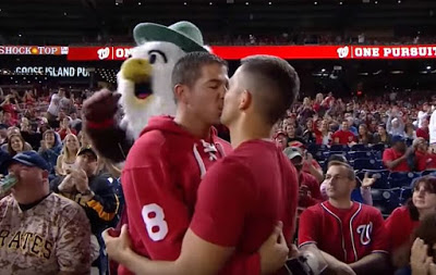 WATCH: Man Proposes to Boyfriend During Baseball Game and The Crowd Goes Wild image